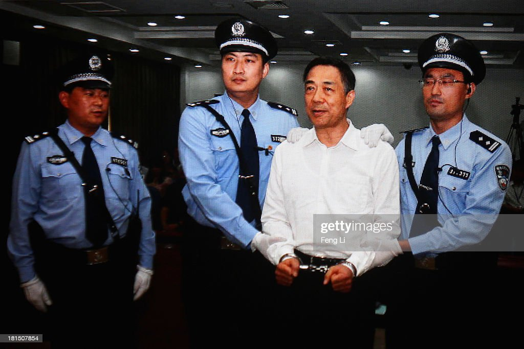 A screen shows the picture of the sentence of Chinese politician <a gi-track='captionPersonalityLinkClicked' href=/galleries/search?phrase=Bo+Xilai&family=editorial&specificpeople=225006 ng-click='$event.stopPropagation()'>Bo Xilai</a> (2nd Right) on September 22, 2013 in Beijing, China. The Jinan Intermediate People's Court announced <a gi-track='captionPersonalityLinkClicked' href=/galleries/search?phrase=Bo+Xilai&family=editorial&specificpeople=225006 ng-click='$event.stopPropagation()'>Bo Xilai</a>, former member of the CPC Central Committee Political Bureau, was sentenced to life imprisonment on Sunday for bribery, embezzlement and abuse of power.