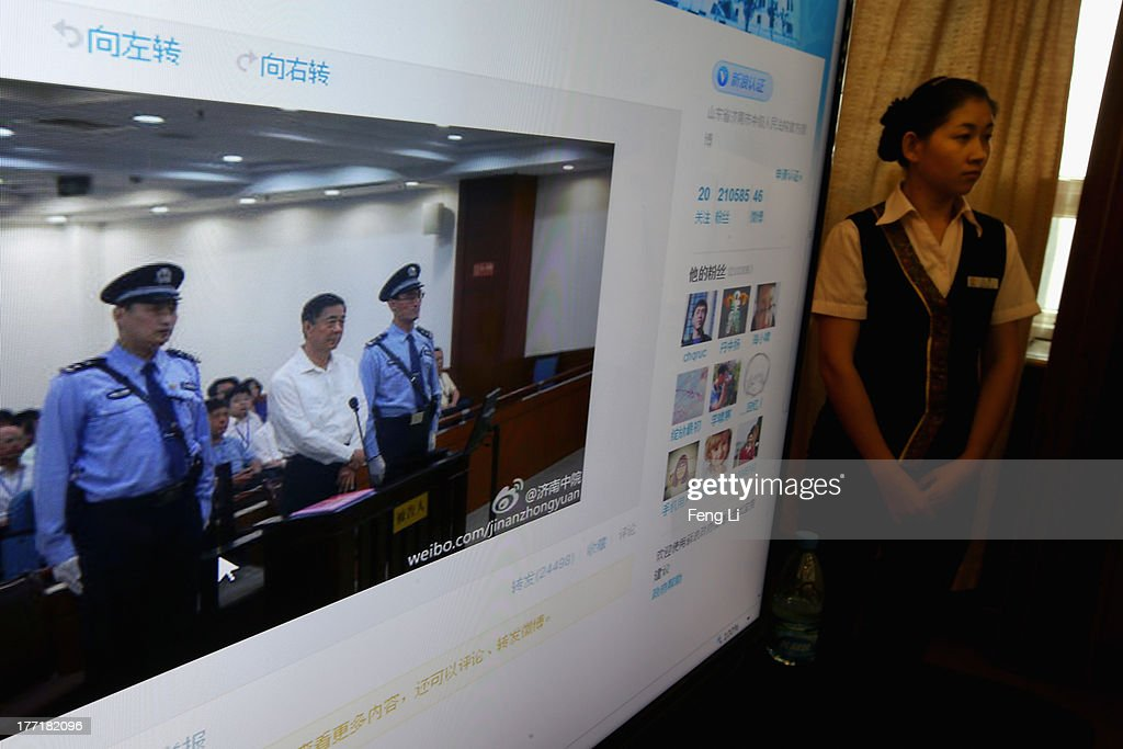 A screen shows the picture of the trial of disgraced Chinese politician Bo Xilai before a press conference in Jihua Hotel on August 22, 2013 in Jinan, China. Former Chinese politician Bo Xilai is standing trial on charges of bribery, corruption and abuse of power. Bo Xilai made global headlines last year when his wife wife Gu Kailai was charged and convicted of murdering British businessman Neil Heywood.