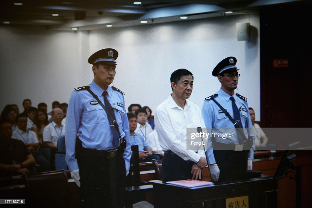 A screen shows the picture of the trial of disgraced Chinese politician Bo Xilai (Center) before a press conference in Jihua Hotel on August 22, 2013 in Jinan, China. Former Chinese politician Bo Xilai is standing trial on charges of bribery, corruption and abuse of power. Bo Xilai made global headlines last year when his wife Gu Kailai was charged and convicted of murdering British businessman Neil Heywood.