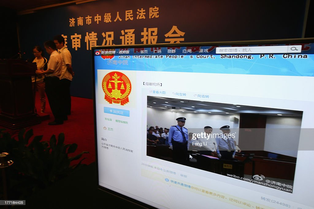 A screen shows the picture of the trial of disgraced Chinese politician Bo Xilai (Center) before a press conference in Jihua Hotel on August 22, 2013 in Jinan, China. Former Chinese politician Bo Xilai is standing trial on charges of bribery, corruption and abuse of power. Bo Xilai made global headlines last year when his wife wife Gu Kailai was charged and convicted of murdering British businessman Neil Heywood.