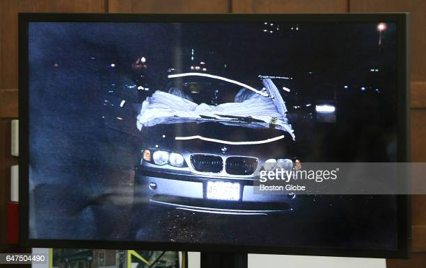 A screen shows the scene described by paramedic David Cioffi who testified that he draped this sheet over the victims' vehicle to shield them from...
