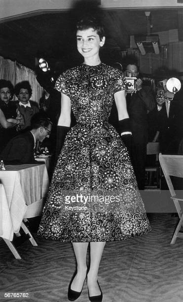 Screen star Audrey Hepburn models a new collection at an Amsterdam fashion show 2nd November 1954