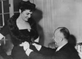Screen star Jane Russell meets French fashion designer Christian Dior in Paris for a fitting of one of Dior's much vaunted 'H' line creations