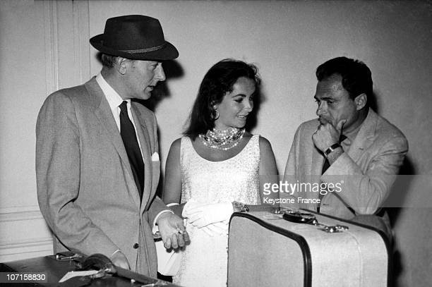 Screen star Liz Taylor with her former husband Michael Wilding and her current husband Michael Todd on right on June 16 1957 in Nice France