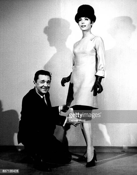 Screen Star's Gown Modeled Bill Travilla shows the mink underskirt to a dress that he created for Diane McBain in the film 'Mary Mary' now playing in...