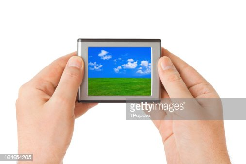 Screen with landscape in hands : Stock Photo