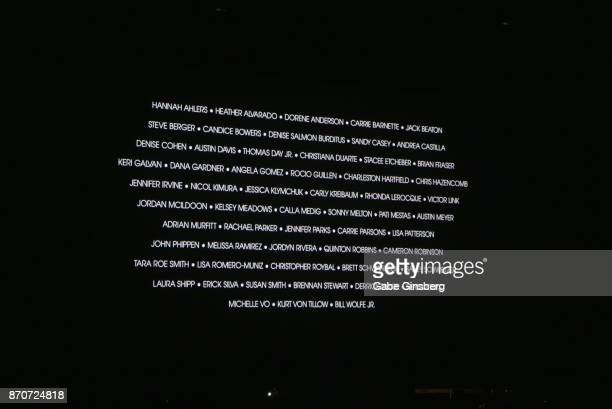 A screen with the 58 names of people who were killed in the mass shooting by Stephen Paddock at the Route 91 Harvest country music festival is...