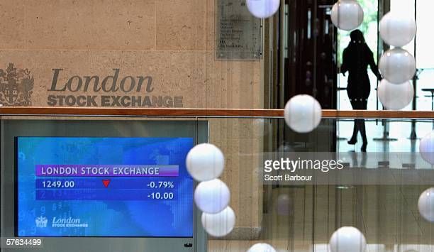 Screens display financial information inside of the London Stock Exchange building on May 17 2006 in London England