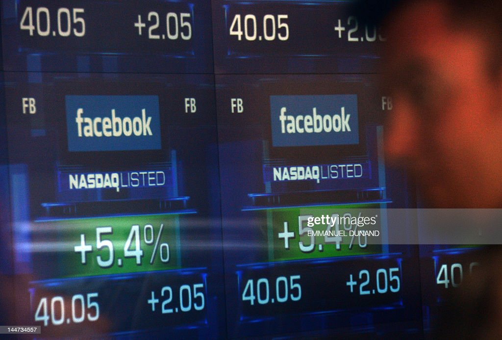 Screens display the start of trading in Facebook shares at the NASDAQ stock exchange on Times Square in New York, on May 18, 2012. Facebook shares saw an opening pop fade Friday as the wildly popular social network made its long-anticipated market debut. The shares, priced at 38 USD in the largest-ever initial public offering (IPO) for a technology company, jumped 12 percent to 42.55 USD in the opening Nasdaq trades before enthusiasm faded. The shares dropped back all the way to the $38 offering price before showing modest gains at midday. AFP PHOTO/Emmanuel Dunand
