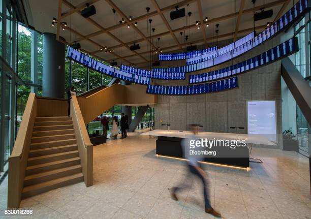 Screens hang in the lobby of the International Business Machines Corp Watson cognitive computing platform Internet of Things center in Munich Germany...