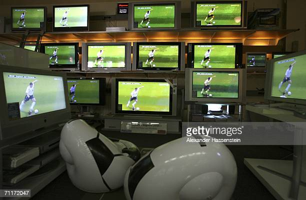 HDTV screens show the FIFA World Cup Germany 2006 Group B match between England and Paraguay at a Berlin radio and television shop on June 10 2006 in...