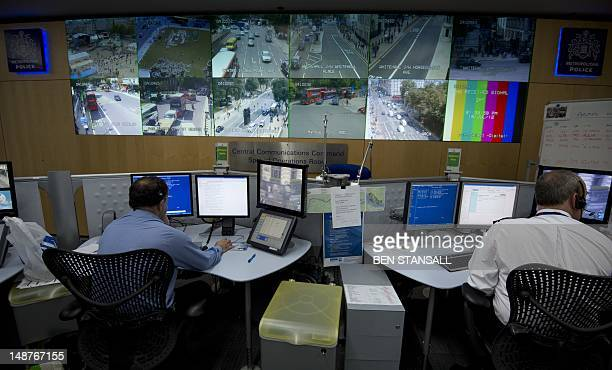 Screens showing CCTV feeds are displayed above police officers working at the Special Operations Room facility which will be the police control room...