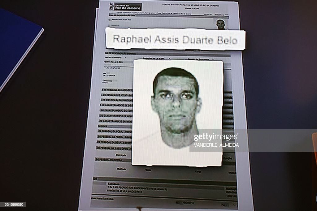 Screenshot from TV of a photo issued by Brazilian police of 41-year-old Raphael Assis Duarte Belo, one of 33 men suspected of gang-raping a 16-year-old girl in Rio de Janeiro on May 27, 2016. The suspects caused an uproar in Brazil when they posted a video of the assault on social media. / AFP / VANDERLEI