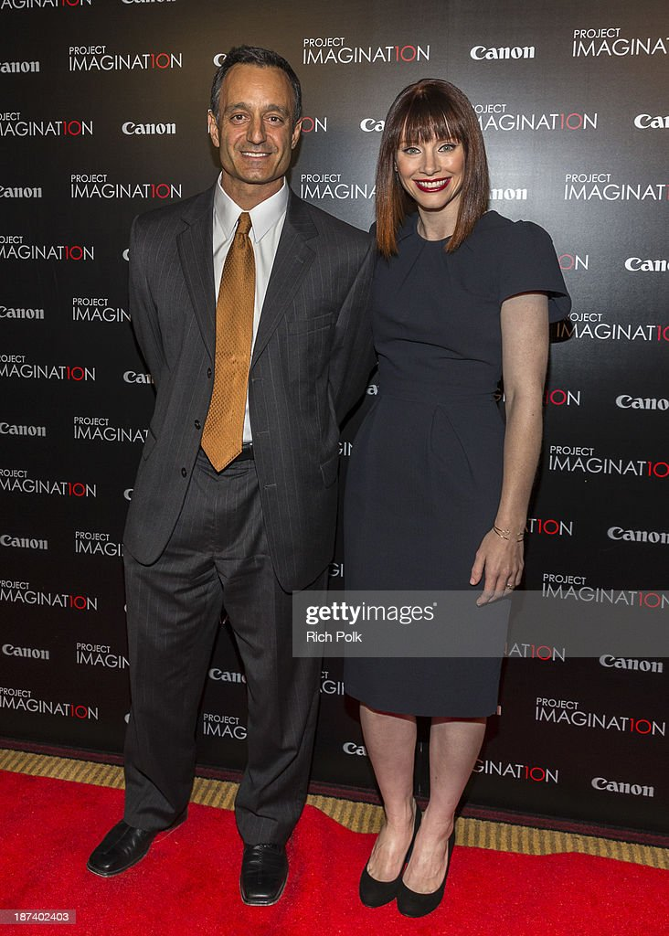 Screenvision's Tony McIlwain and the first graduating director of Canon's Project Imagin8ion, <a gi-track='captionPersonalityLinkClicked' href=/galleries/search?phrase=Bryce+Dallas+Howard&family=editorial&specificpeople=156411 ng-click='$event.stopPropagation()'>Bryce Dallas Howard</a> arrives at Canon's Los Angeles Screening Of The Project Imaginat10n Film Festival at Pacific Theaters at the Grove on November 7, 2013 in Los Angeles, California.