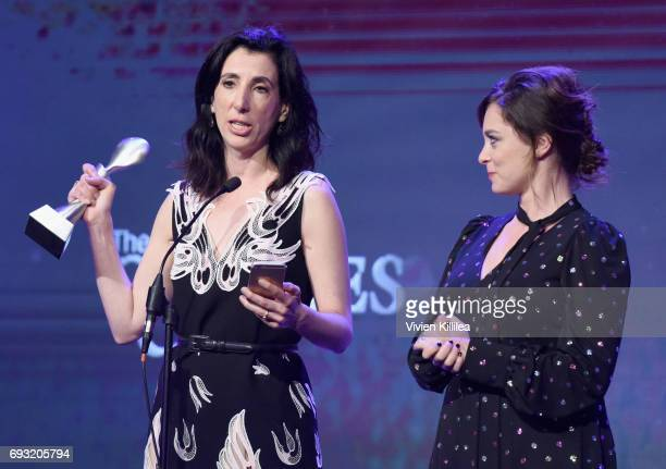 Screenwriter Aline Brosh McKenna accepts an award with actress Rachel Bloom onstage during the 42nd Annual Gracie Awards hosted by The Alliance for...