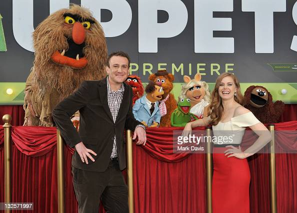 Screenwriter and Executive Producer Jason Segel and actress Amy Adams arrive at the premiere of Walt Disney Pictures' 'The Muppets' held at the El...
