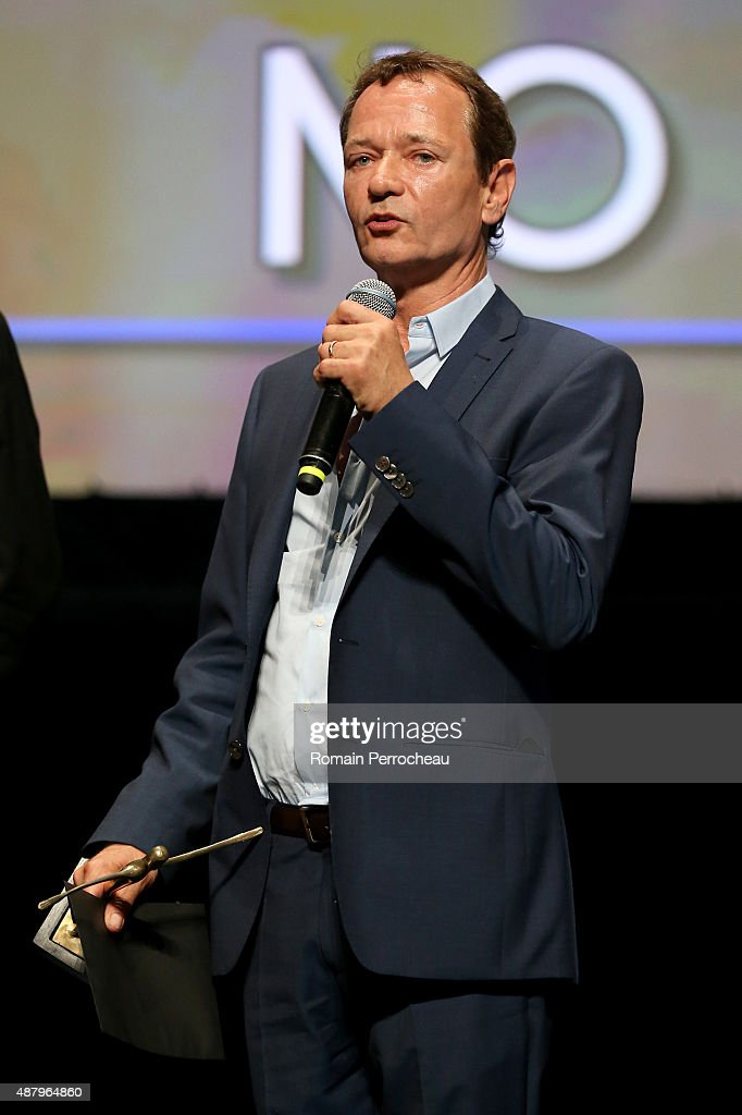 Screenwriter and Producer Paul Abbott winner of the Best Foreign Movie Prize poses at the photocall for the winner during the closing ceremony of the...