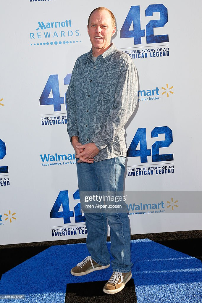 Screenwriter <a gi-track='captionPersonalityLinkClicked' href=/galleries/search?phrase=Brian+Helgeland&family=editorial&specificpeople=699737 ng-click='$event.stopPropagation()'>Brian Helgeland</a> attends the premiere of Warner Bros. Pictures' And Legendary Pictures' '42' at TCL Chinese Theatre on April 9, 2013 in Hollywood, California.