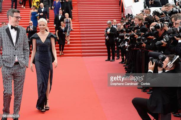 Screenwriter Brian Selznic and actress Michelle Williams leave the 'Wonderstruck' screening during the 70th annual Cannes Film Festival at Palais des...