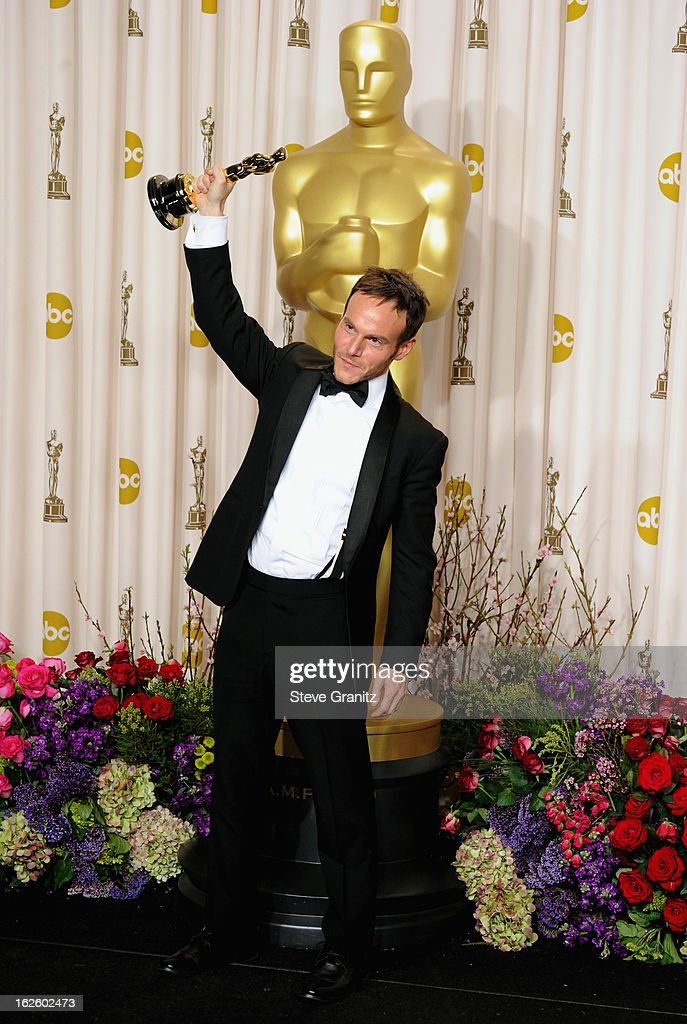 Screenwriter Chris Terrio poses in the press room during the Oscars at the Loews Hollywood Hotel on February 24, 2013 in Hollywood, California.