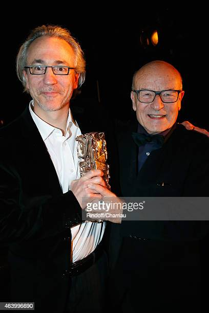 Screenwriter Cyril Gely and Director Volker Schloendorff pose backstage with the award their received for the Best Adapted Screenplay for...