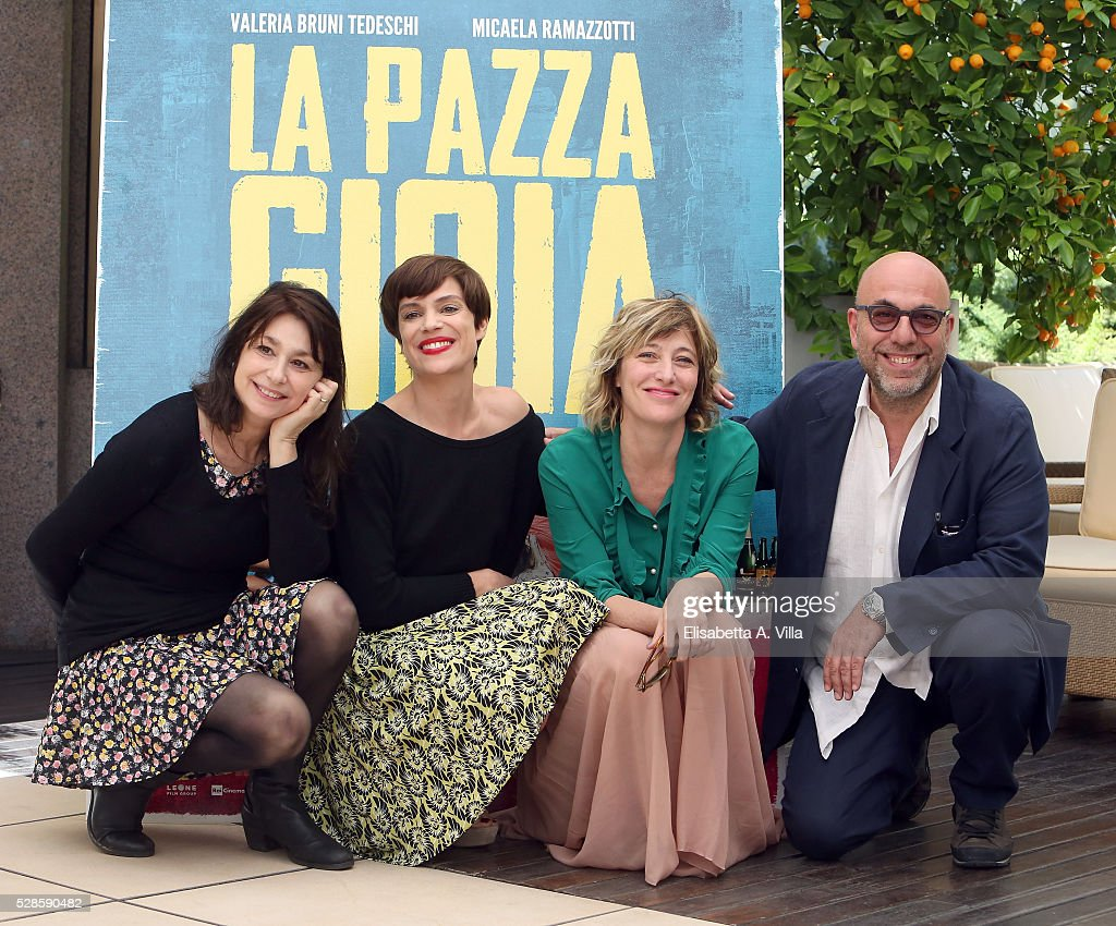 Screenwriter Francesca Archibugi, actresses <a gi-track='captionPersonalityLinkClicked' href=/galleries/search?phrase=Micaela+Ramazzotti&family=editorial&specificpeople=2855748 ng-click='$event.stopPropagation()'>Micaela Ramazzotti</a>, Valeria Bruni Tedeschi and director <a gi-track='captionPersonalityLinkClicked' href=/galleries/search?phrase=Paolo+Virzi&family=editorial&specificpeople=3021843 ng-click='$event.stopPropagation()'>Paolo Virzi</a> attend a photocall for 'La Pazza Gioia' at Visconti Palace Hotel on May 6, 2016 in Rome, Italy.