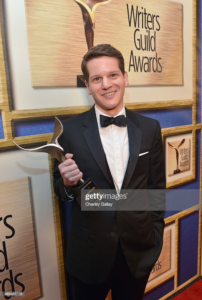 Screenwriter Graham Moore poses with the Best Adapted Screenplay award for 'The Imitation Game' during the 2015 Writers Guild Awards LA Ceremony at...