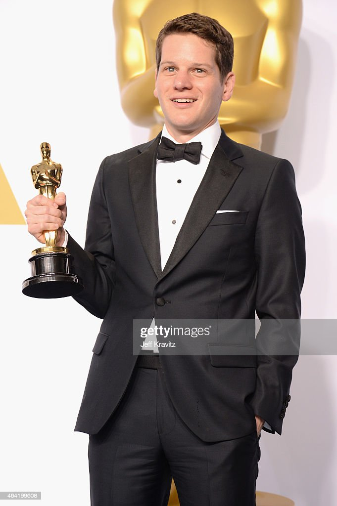 Screenwriter Graham Moore with the award for best adapted screenplay for 'The Imitation Game' poses in the press room during the 87th Annual Academy...