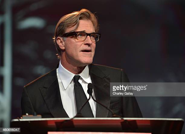 Screenwriter John Lee Hancock speaks onstage during the 25th annual Palm Springs International Film Festival awards gala at Palm Springs Convention...