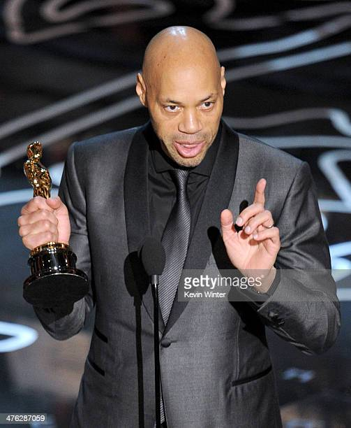 Screenwriter John Ridley accepts the Best Screenplay Based on Material Previously Produced or Published award for '12 Years a Slave' onstage during...