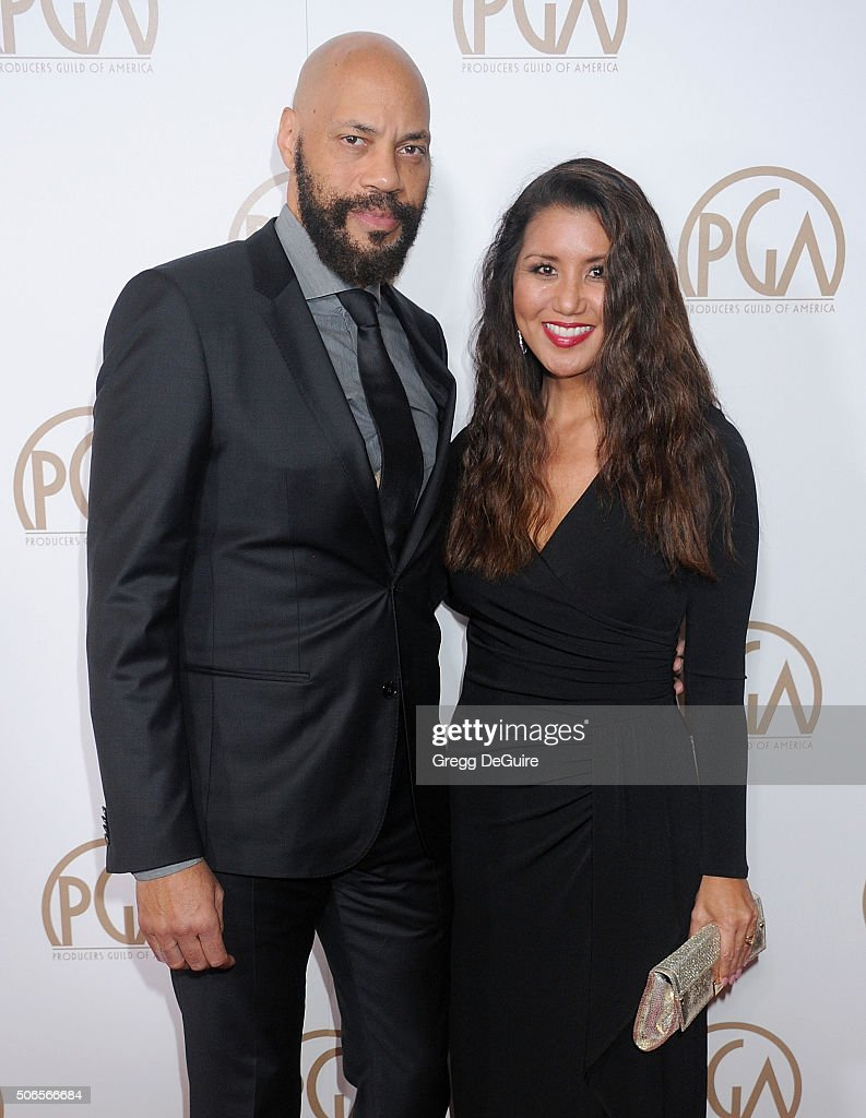 Screenwriter John Ridley and Gayle Ridley arrive at the 27th Annual Producers Guild Awards at the Hyatt Regency Century Plaza on January 23, 2016 in Century City, California.