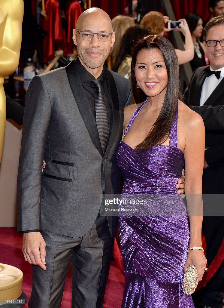Screenwriter John Ridley and wife Gayle Ridley attend the Oscars held at Hollywood Highland Center on March 2 2014 in Hollywood California
