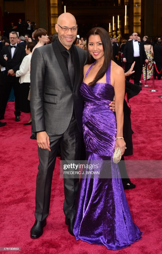 Screenwriter John Ridley ('12 Years A Slave') arrives with wife Gayle on the red carpet for the 86th Academy Awards on March 2nd, 2014 in Hollywood, California.