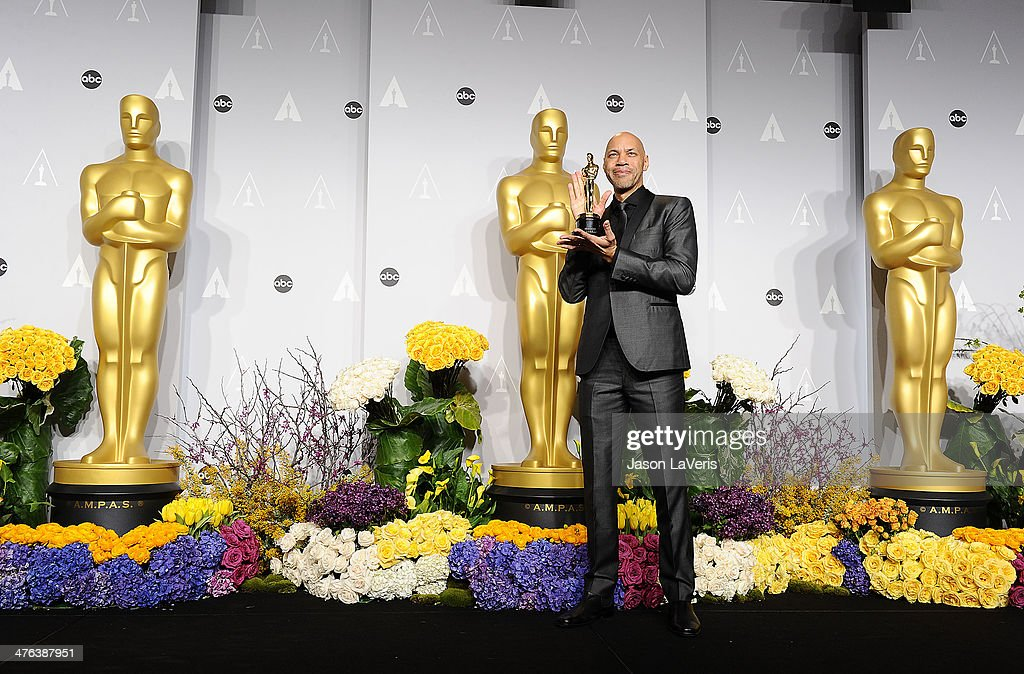 Screenwriter John Ridley poses in the press room at the 86th annual Academy Awards at Dolby Theatre on March 2, 2014 in Hollywood, California.