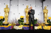 Screenwriter John Ridley poses in the press room at the 86th annual Academy Awards at Dolby Theatre on March 2 2014 in Hollywood California