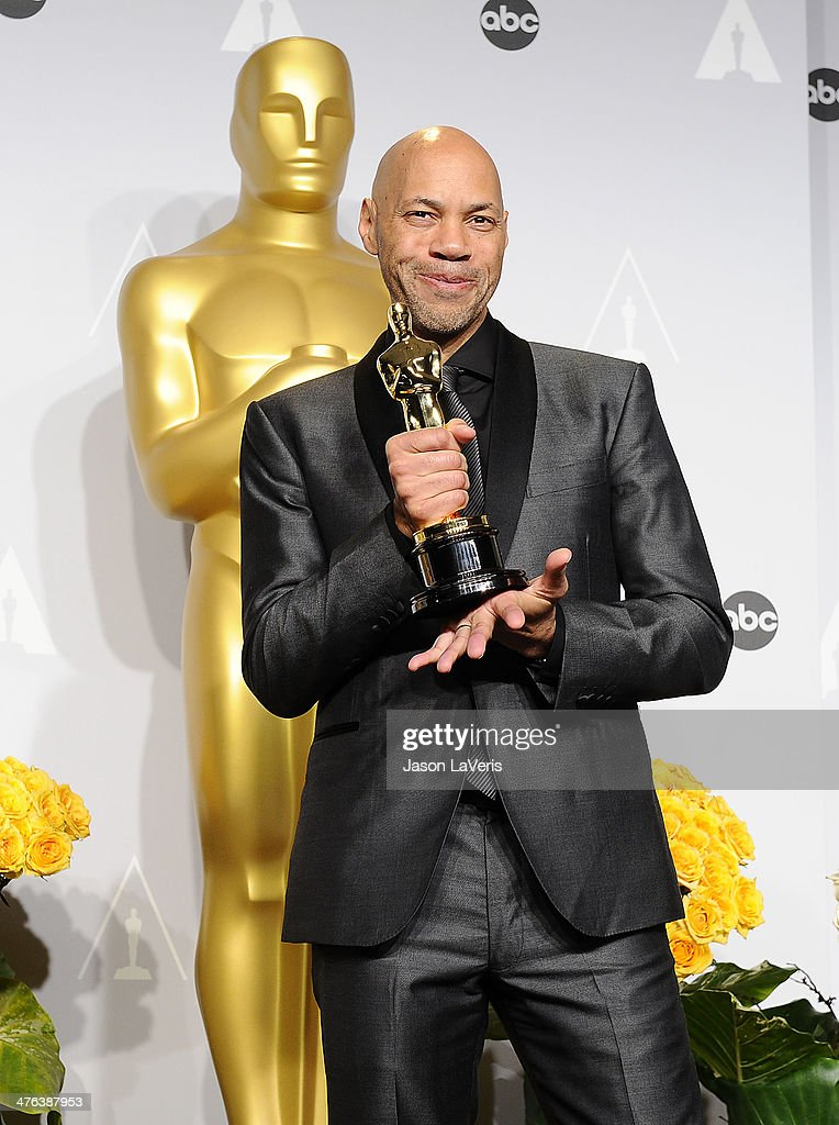 Screenwriter <a gi-track='captionPersonalityLinkClicked' href=/galleries/search?phrase=John+Ridley&family=editorial&specificpeople=2310489 ng-click='$event.stopPropagation()'>John Ridley</a> poses in the press room at the 86th annual Academy Awards at Dolby Theatre on March 2, 2014 in Hollywood, California.