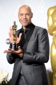 Screenwriter John Ridley poses in the press room during the Oscars at Loews Hollywood Hotel on March 2 2014 in Hollywood California