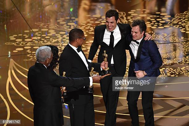 Screenwriter Josh Singer and actor Mark Ruffalo of Best Picture winner 'Spotlight' celebrate onstage with actor Morgan Freeman during the 88th Annual...