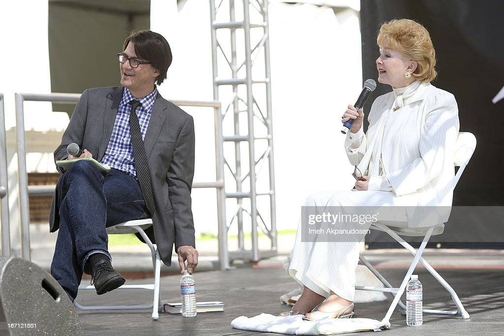 Screenwriter Mark Olsen (L) and actress/author <a gi-track='captionPersonalityLinkClicked' href=/galleries/search?phrase=Debbie+Reynolds&family=editorial&specificpeople=121536 ng-click='$event.stopPropagation()'>Debbie Reynolds</a> speak onstage at the 18th Annual LA Times Festival Of Books at USC on April 20, 2013 in Los Angeles, California.