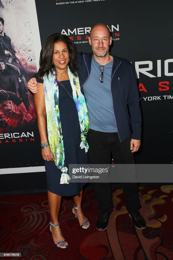 Screenwriter Michael Finch and guest attend a Screening of CBS Films and Lionsgate's 'American Assassin' at TCL Chinese Theatre on September 12, 2017 in Hollywood, California.