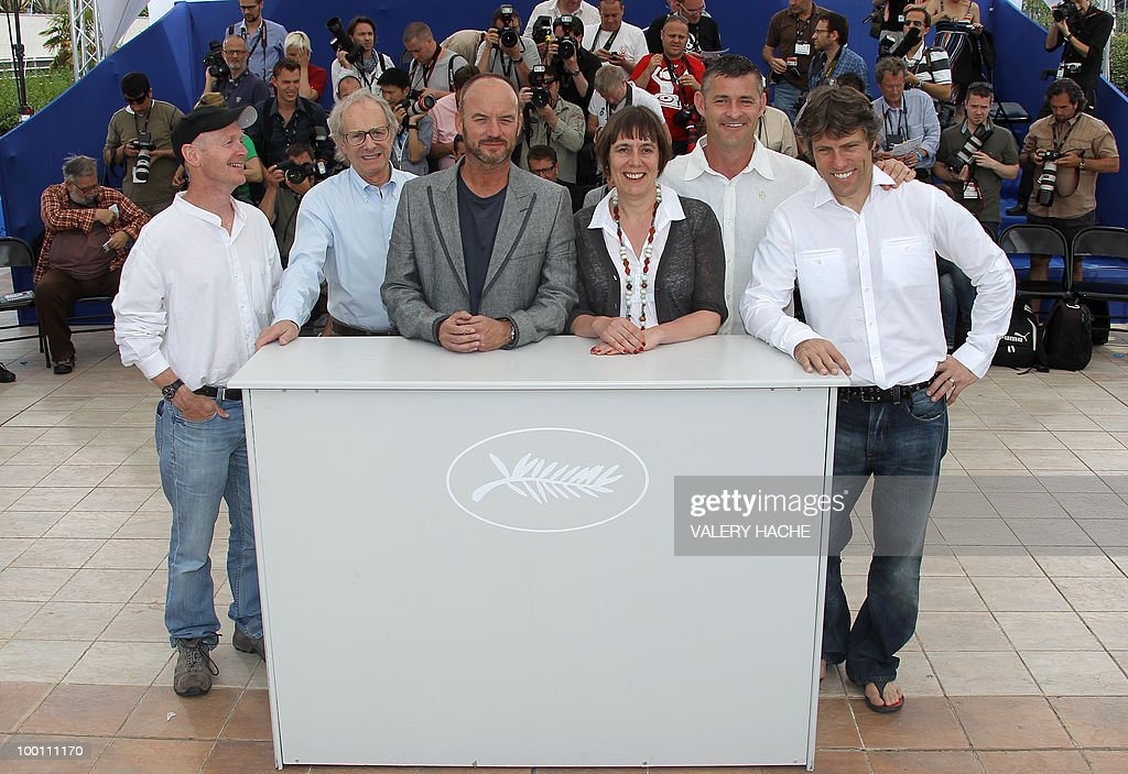 Screenwriter Paul Laverty British director Ken Loach, British actor Mark Womack, producer Rebecca O'Brien, British actor Trevor Williams and actor John Bishop pose during the photocall 'Route Irish' presented in competition at the 63rd Cannes Film Festival on May 21, 2010 in Cannes.
