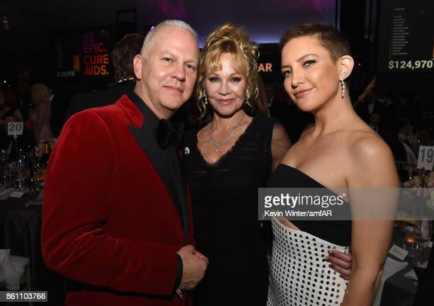 Screenwriter Ryan Murphy actors Melanie Griffith and Kate Hudson attend the amfAR Gala Los Angeles 2017 at Ron Burkle's Green Acres Estate on October...