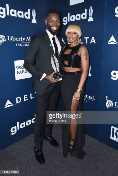 Screenwriter Tarell Alvin McCraney and singer Mary J Blige pose with the Outstanding Film Wide Release award for 'Moonlight' during the 28th Annual...