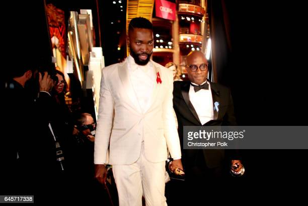 Screenwriter Tarell Alvin McCraney and writer/director Barry Jenkins accept the Best Adapted Screenplay award for 'Moonlight' onstage during the 89th...