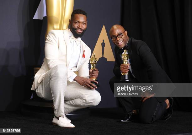 Screenwriter Tarell Alvin McCraney and writer/director Barry Jenkins winners of Best Adapted Screenplay for 'Moonlight' pose in the press room at the...
