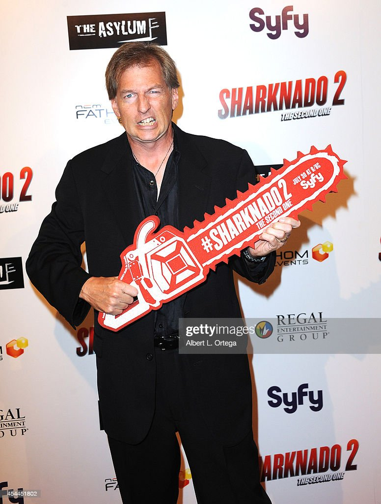 Screenwriter Thunder Levin arrives for the Premiere Of The Asylum & Fathom Events' 'Sharknado 2: The Second One' held at Regal Cinemas L.A. Live on August 21, 2014 in Los Angeles, California.