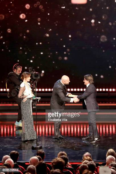 Screenwriter Tonino Zera receives the Best Screenplay Award from Valeria Bilello and Marco D'Amore during the 61 David Di Donatello ceremony on March...