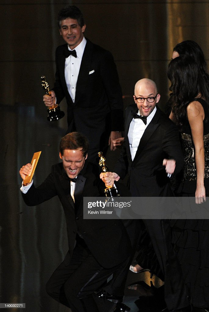 Screenwriters Alexander Payne Jim Rash and Nat Faxon accept the Best Adapted Screenplay Award for 'The Descendants' onstage during the 84th Annual...