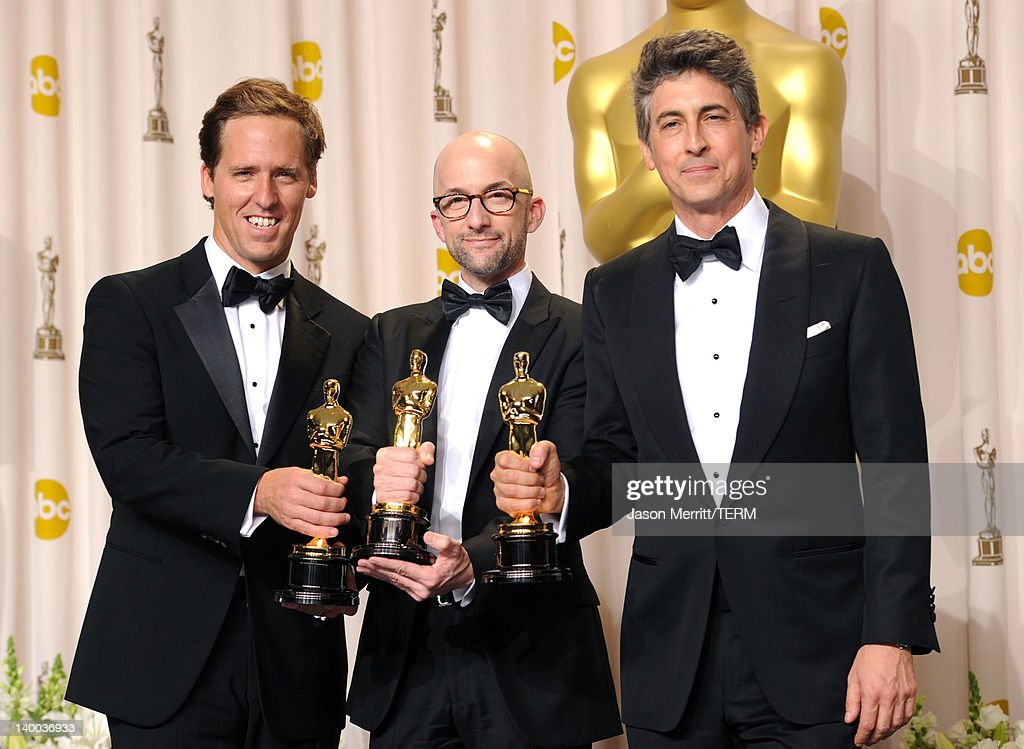 Screenwriters Nat Faxon Jim Nash and Alexander Payne winners of the Best Adapted Screenplay Award for 'The Descendants' pose in the press room at the...