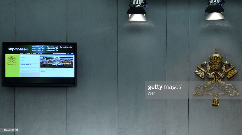 A screesn displays the pontif's twitter adreess during a press conference to announce that the pontif will join Twitter later in the month on December 3, 2012 at the Vatican